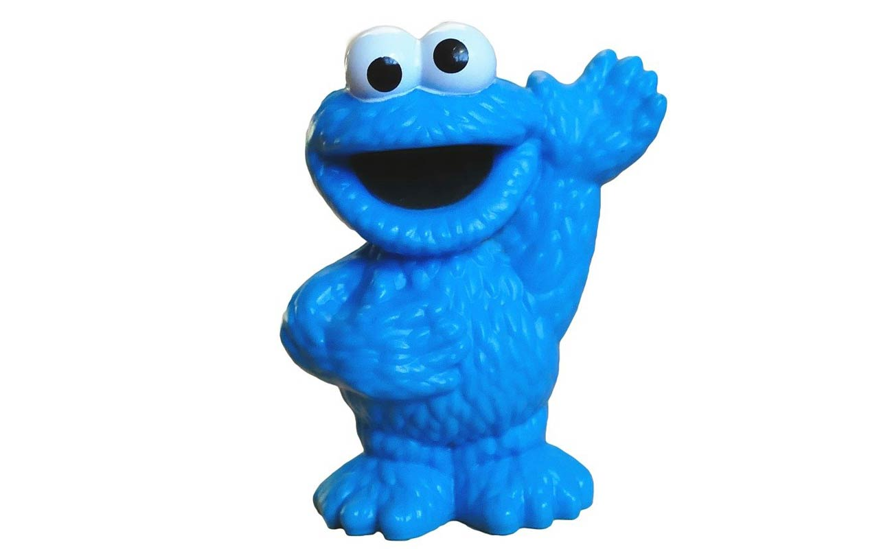 A picture of a Cookie Monster figurine. Cookie Monster is an example of a memorable character you could use with the Pegword system.