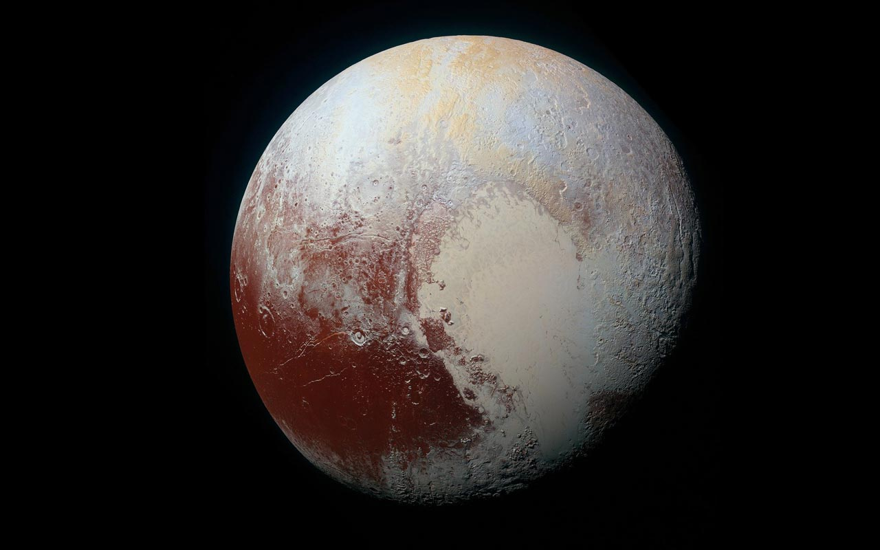 A photo of Pluto, which was previously considered a planet, until it was downgraded in 2006 to a dwarf planet.