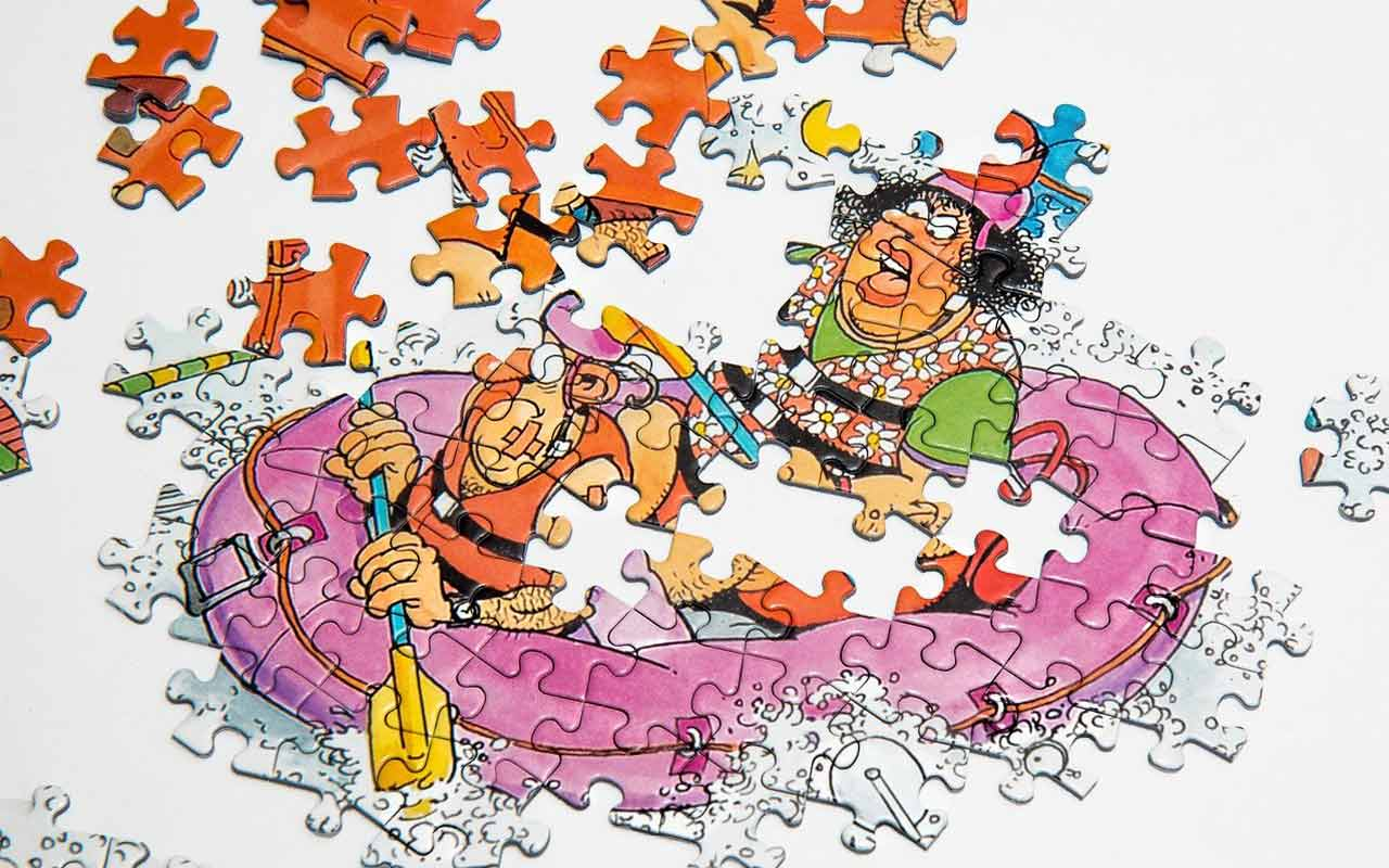 An incomplete jigsaw puzzle of a cartoon couple in an inflatable pink raft.