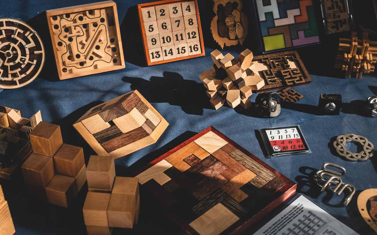 Wooden puzzles sit on a table. Brain games can help boost your memory (just not the ones on your smartphone).
