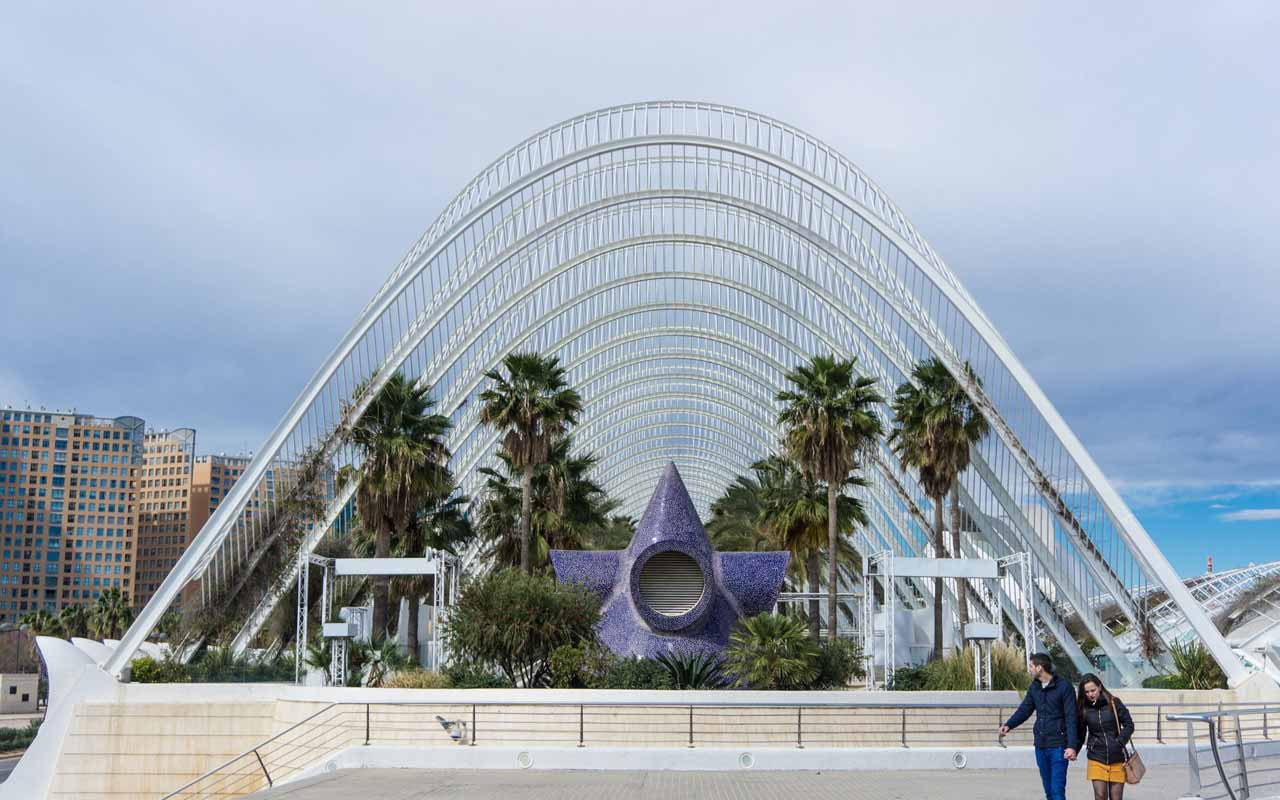 A couple walks by The Umbracle in Valencia, Spain.