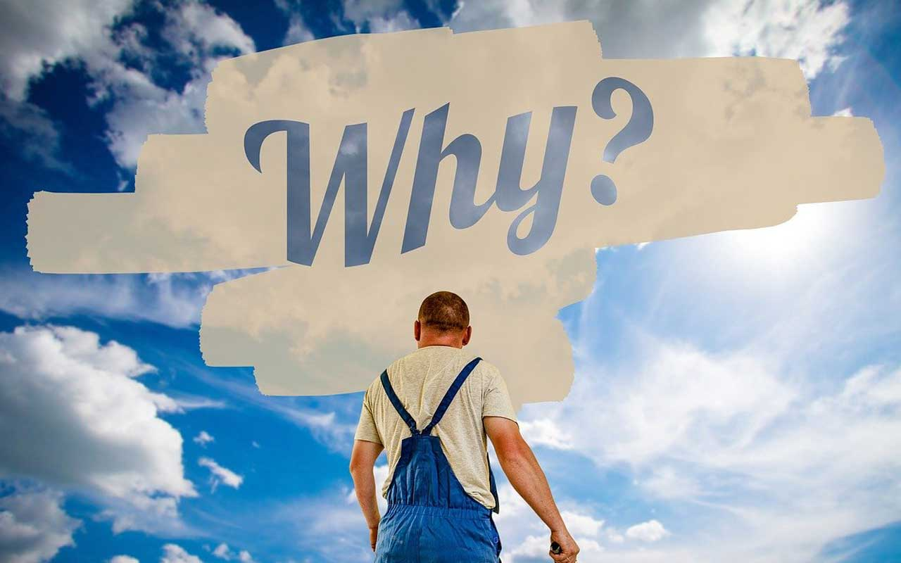 "A man in overalls stands in front of a blue sky, with the word ""why"" painted across the sky."