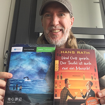 Anthony Metivier reading books in Chinese and German