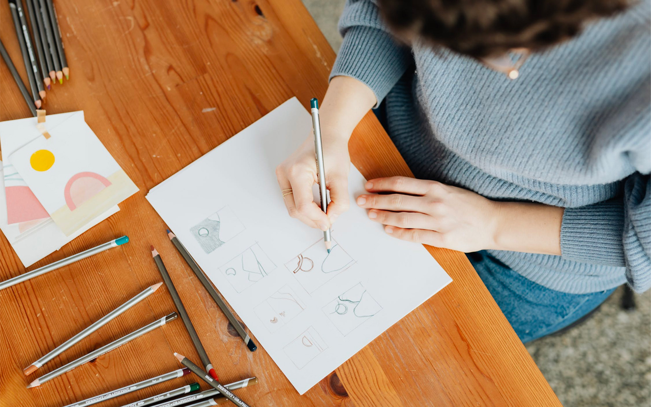 woman drawing graphs by hand to improve reading comprehension