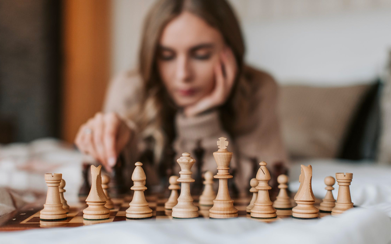 a woman playing chess