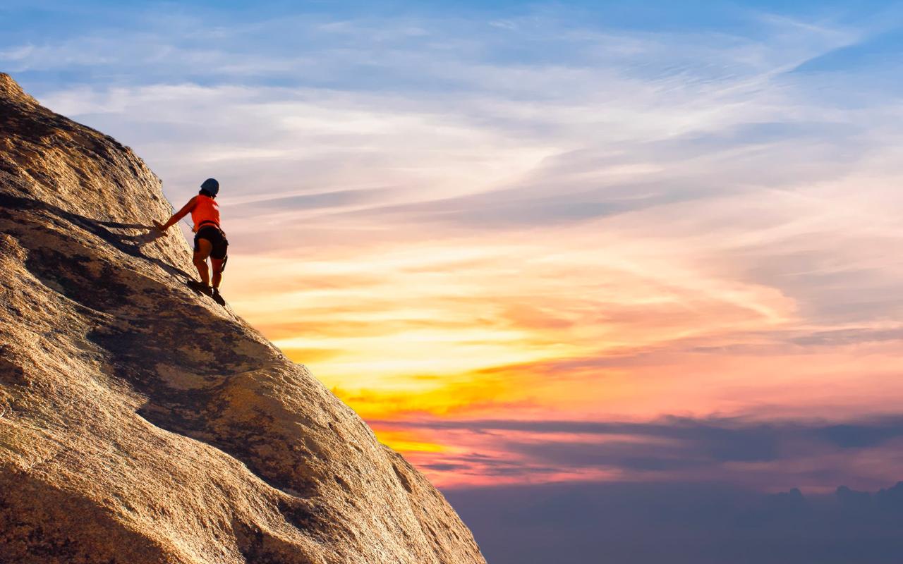 a woman climbing a mountain