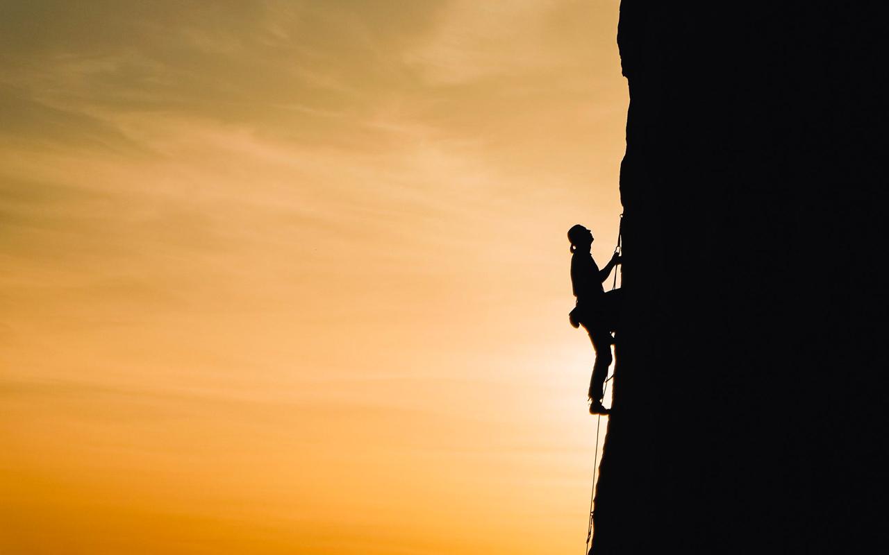 a man climbing a mountain