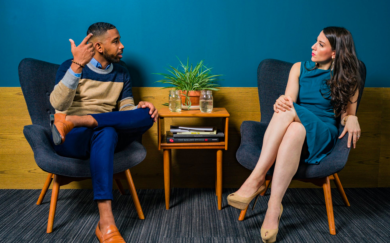 a woman is listening a man talk