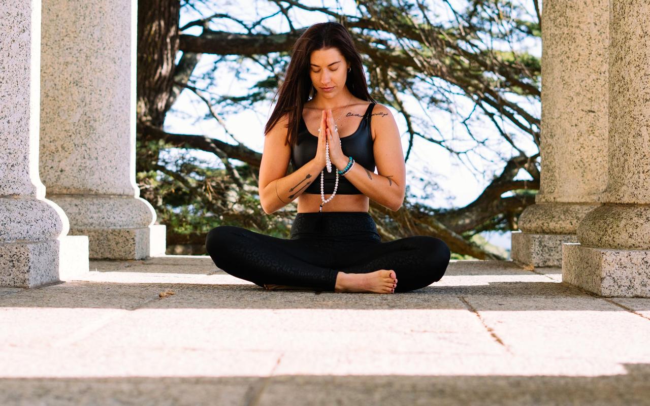 a woman is practising zen