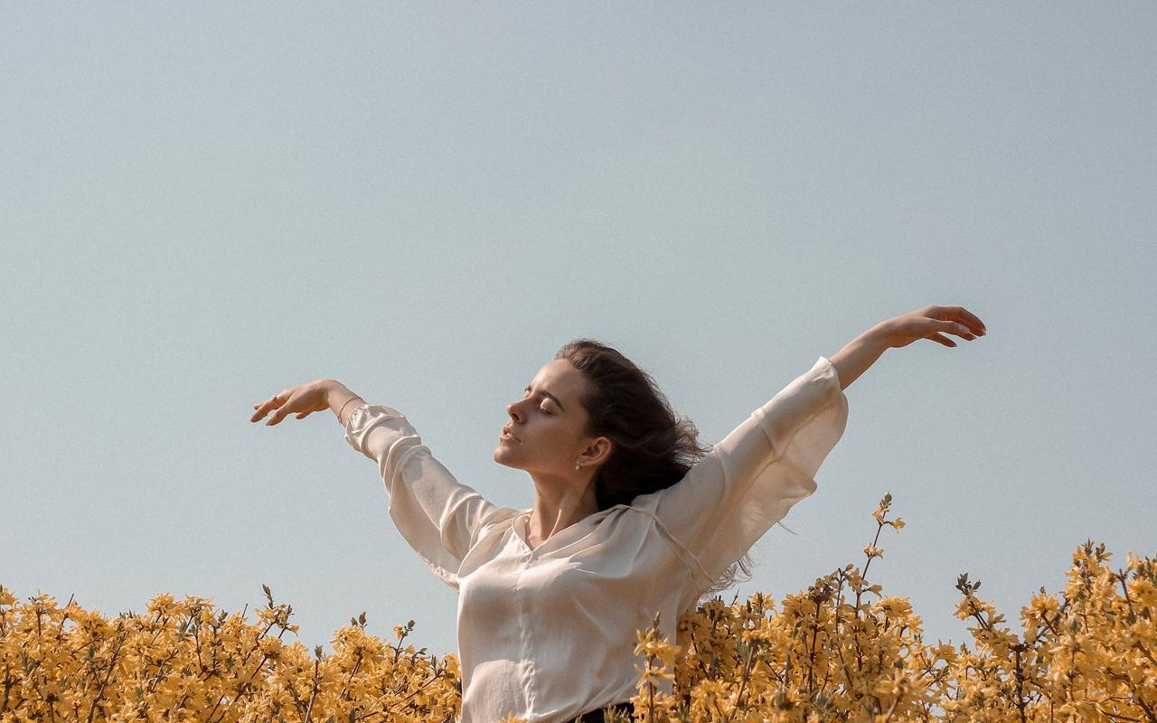 a woman feeling free in a field