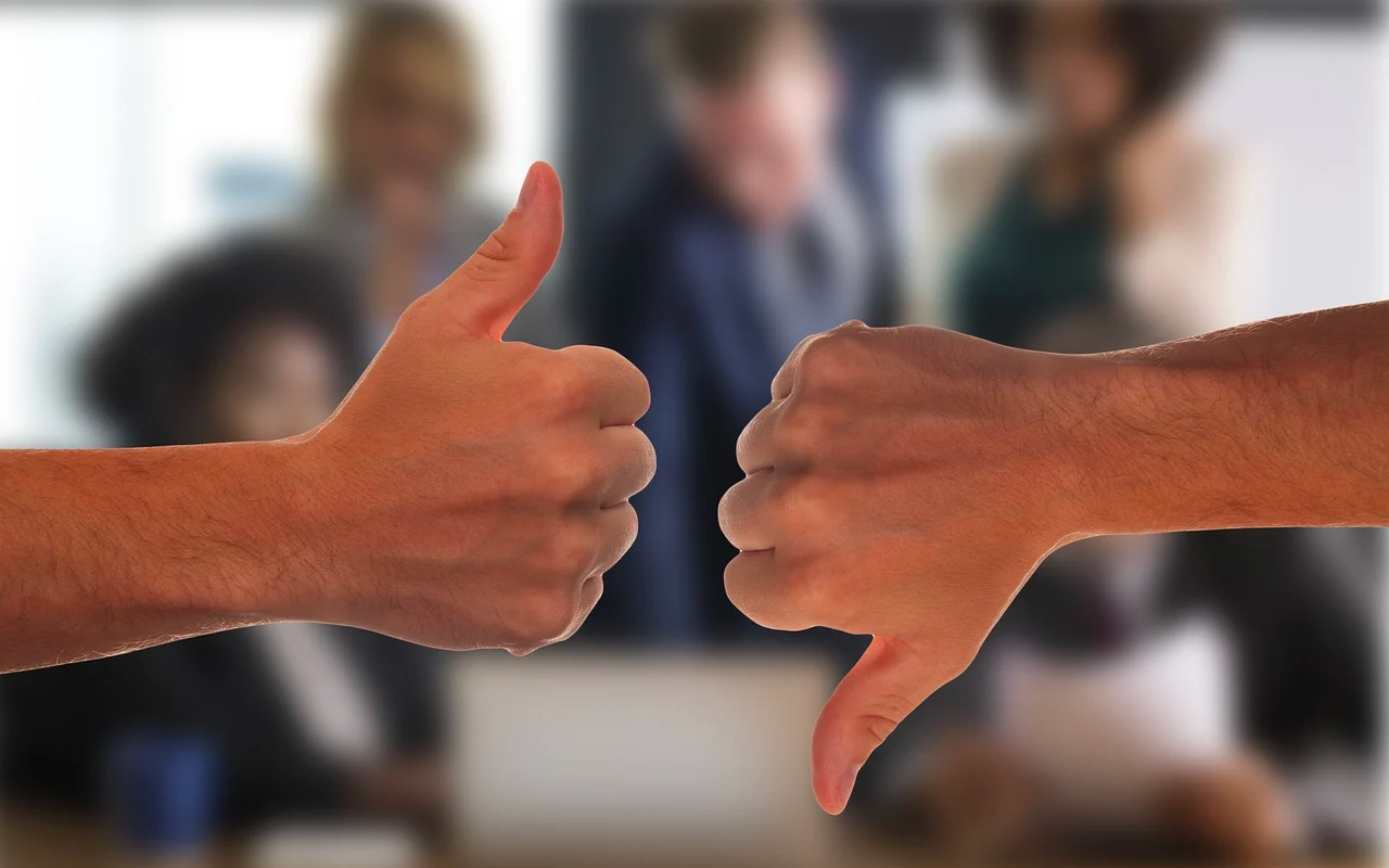 positive and negative expressed by thumbs up and thumbs down