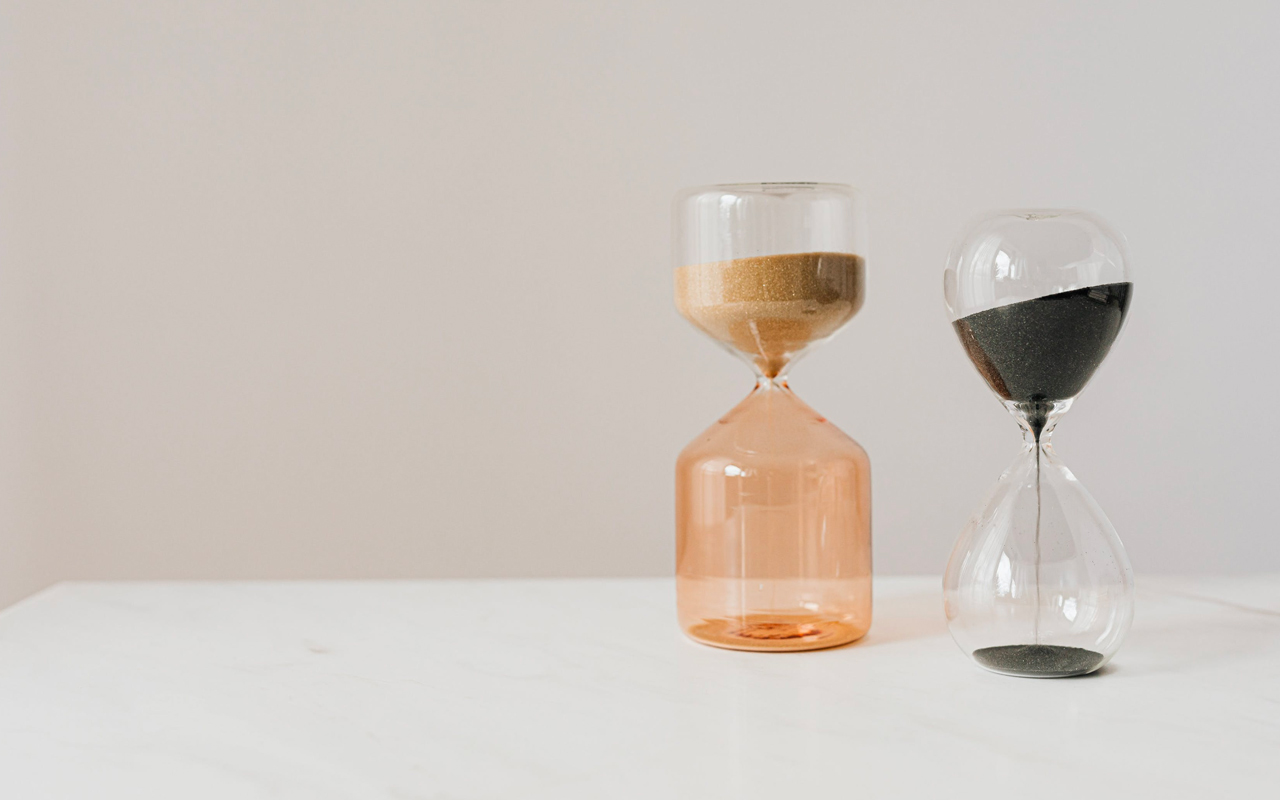 two sand timers on a table