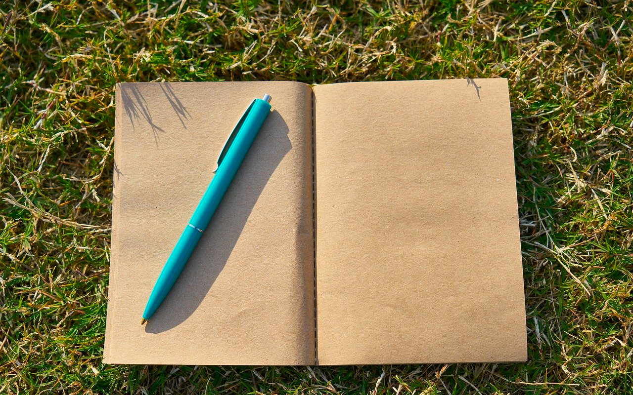 a blank note book and a pen