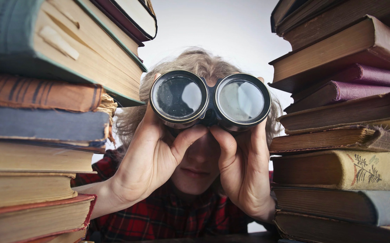 a person uses telescope between books