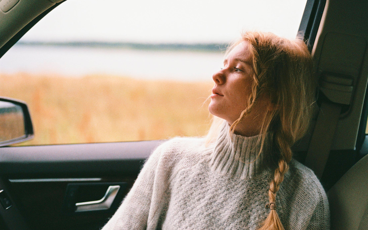 a women is thinking in a car