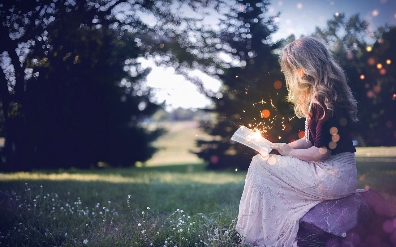 a woman with a magic book