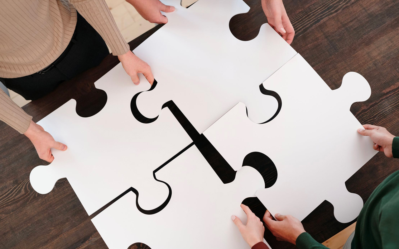 people are putting together a puzzle