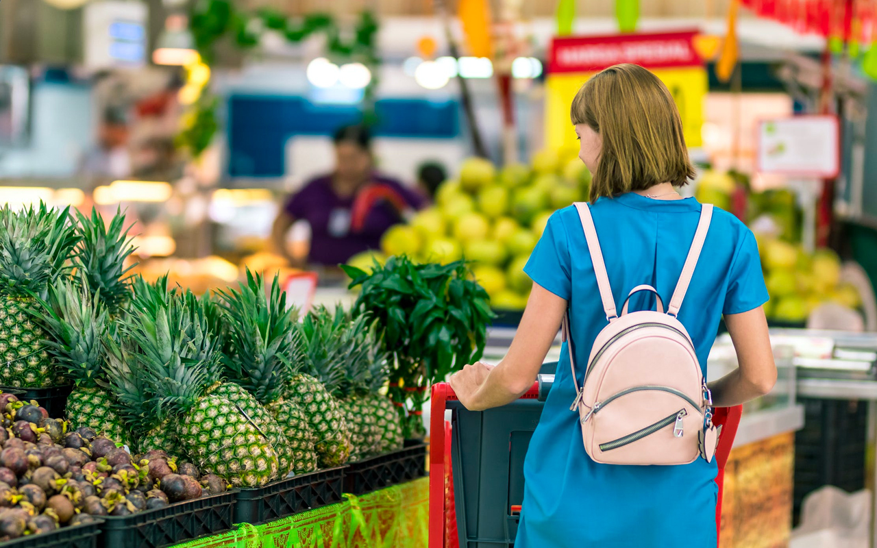 blue dress woman is grocery shopping