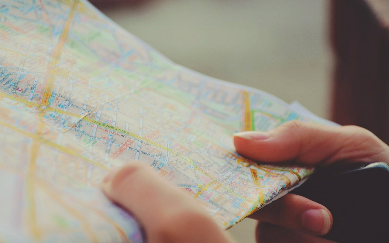 a person is holding a map