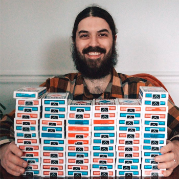 Braden Adams with 70 decks of playing cards