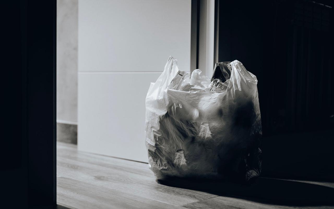 a bag of trash in door