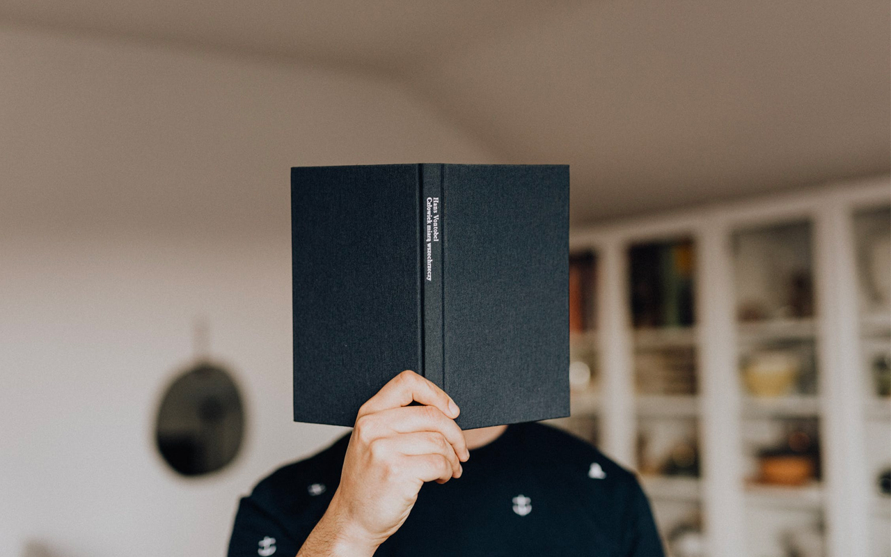 a man with a black book