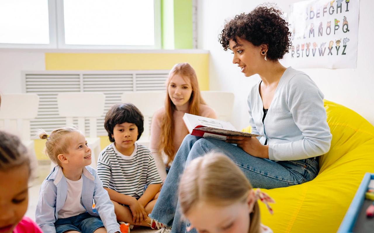 a teacher teaching kids to read