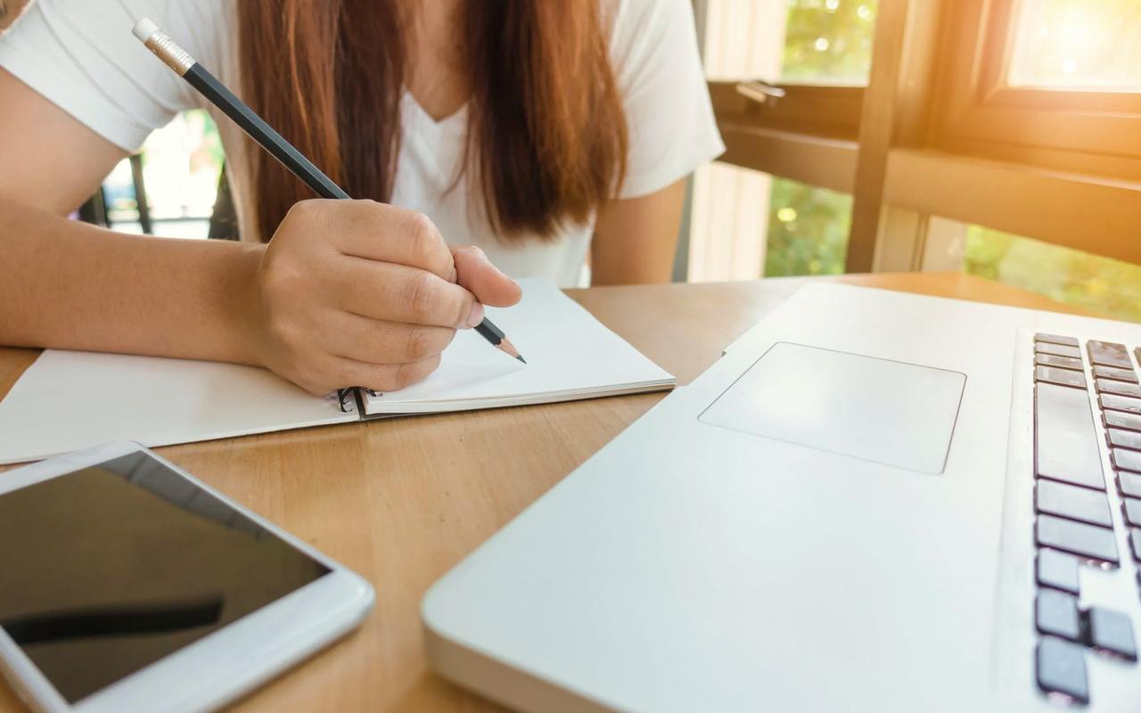 a woman focuses on study