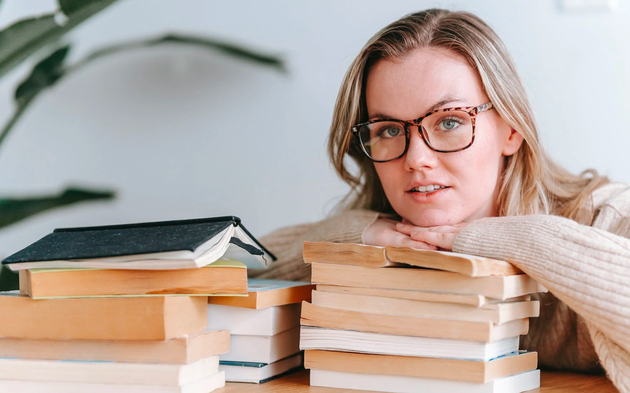 woman wears glasses and likes books