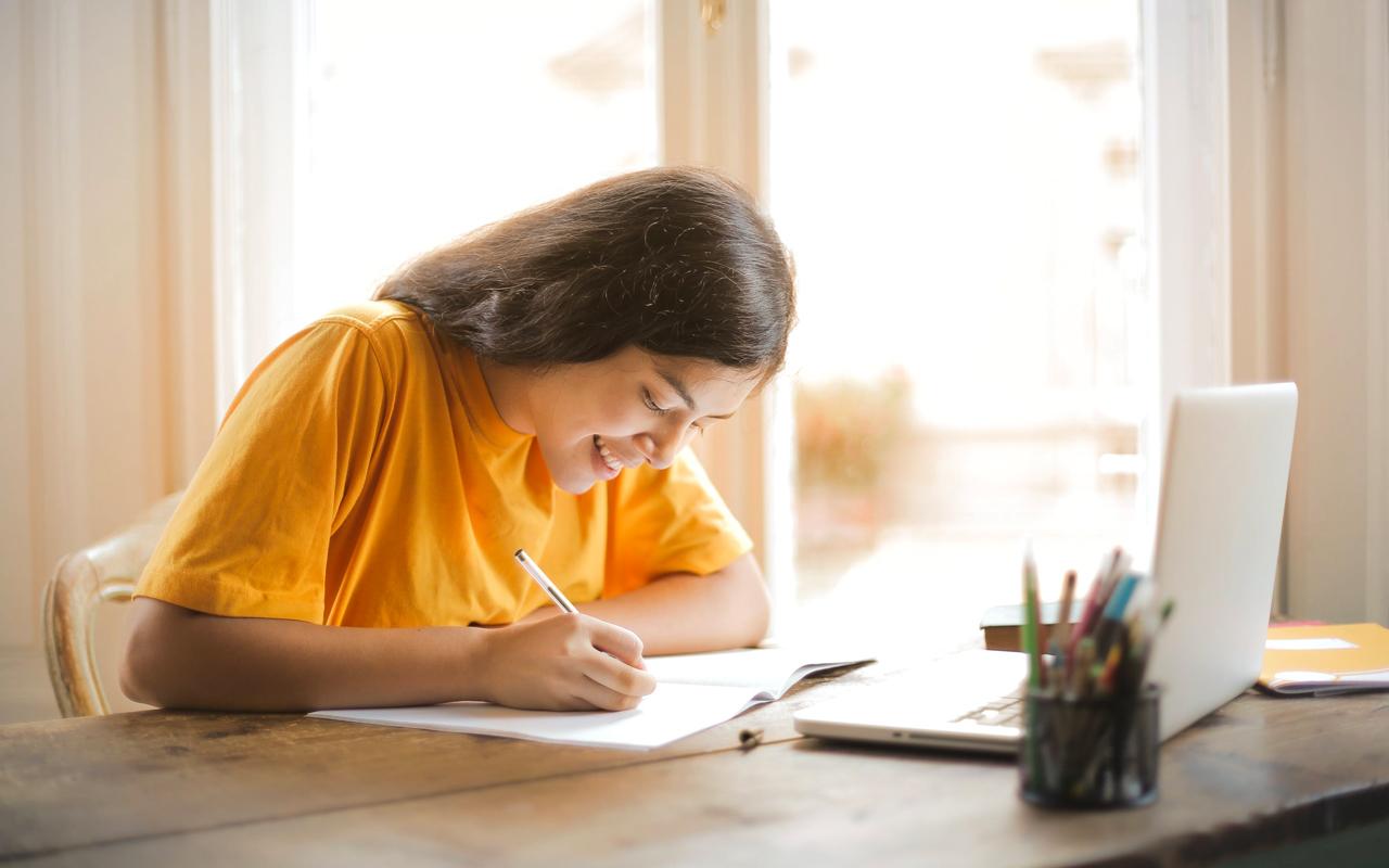 yellow shirt girl learning happily